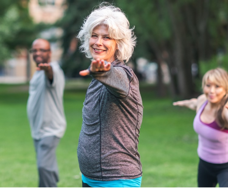 older adults doing fitness in a park